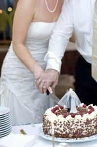 8584544-bride-and-groom-cutting-their-wedding-cake-together